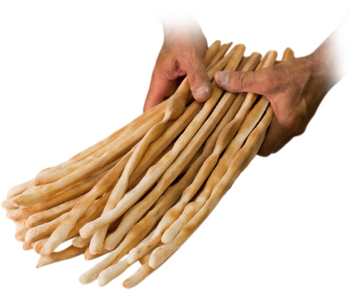 Hands holding breadsticks